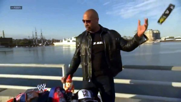 The Rock throws away John Cena stuff.